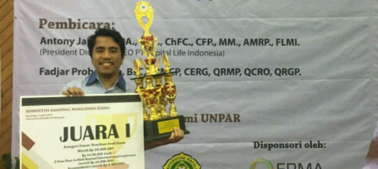 Potret seorang Dosen UISI yang raih Juara 1 Kategori Umum pada Kompetisi Nasional